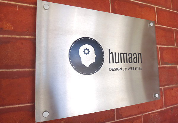 Humaan Web Design acid etched stainless steel sign
