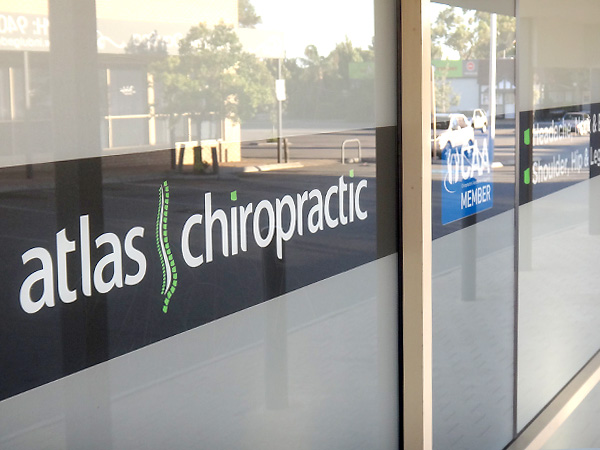 Atlas Chiropractic cut vinyl window graphics detail